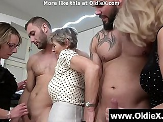 Two young studs fucked by three moms