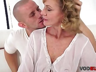 Mature lady seduces a young..