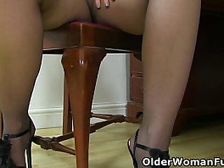 British milf Filthy Emma tears open her tights and fucks her shaven cunny with a dildo (now available in Full HD 1080P). Bonus video: English mature Sammie.