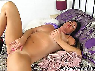 Suntanned mature Leah from the UK plays with her fanny till her cunt lips spread wide open (brand NEW video available in Full HD 1080P). Bonus video: UK mature Karina.